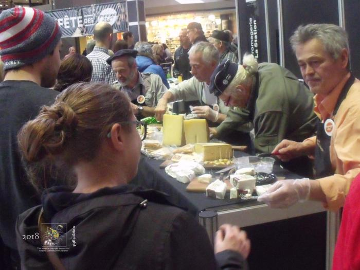Artisants conversant with fine cheese avail samples to public during Montreal en Lumierre.