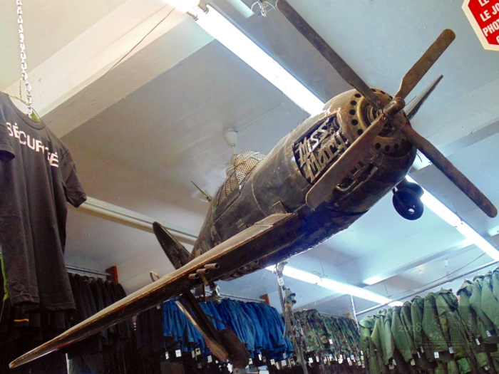American WW2 fighter buzzing over racks and racks of clothing is very unlikely sight anywhere except in Montreal.