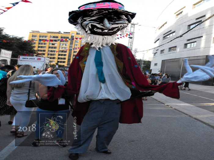 My picture depicts an old cur-mudgeon, one of many tall buskers walking on stilts that populate the Quartier-des-spectacles.
